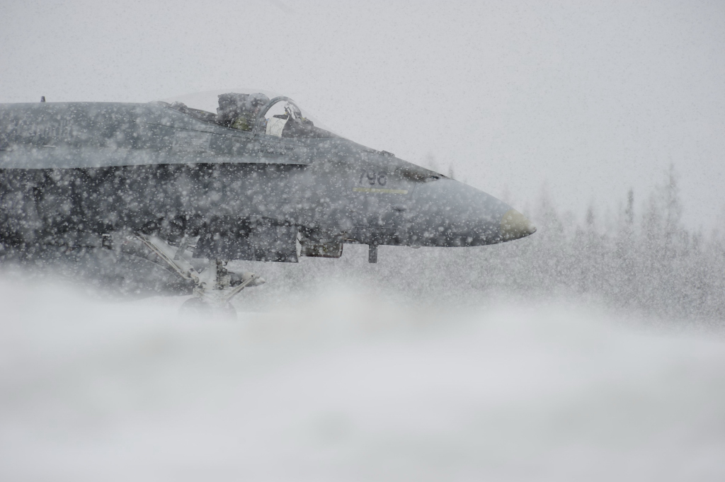 A CF-18 Hornet taxis on the runway during Operation SPRING FORWARD in Yellowknife, Northwest Territories on April 9, 2014. Photo: Cpl Kevin McMillan, Canadian Forces Combat Camera.