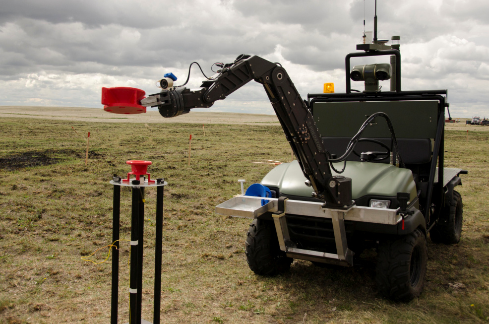 The MATS vehicle pictured investigates a highly radioactive material using its sophisticated robotic arm during a trial at DRDC – Suffield Research Centre.