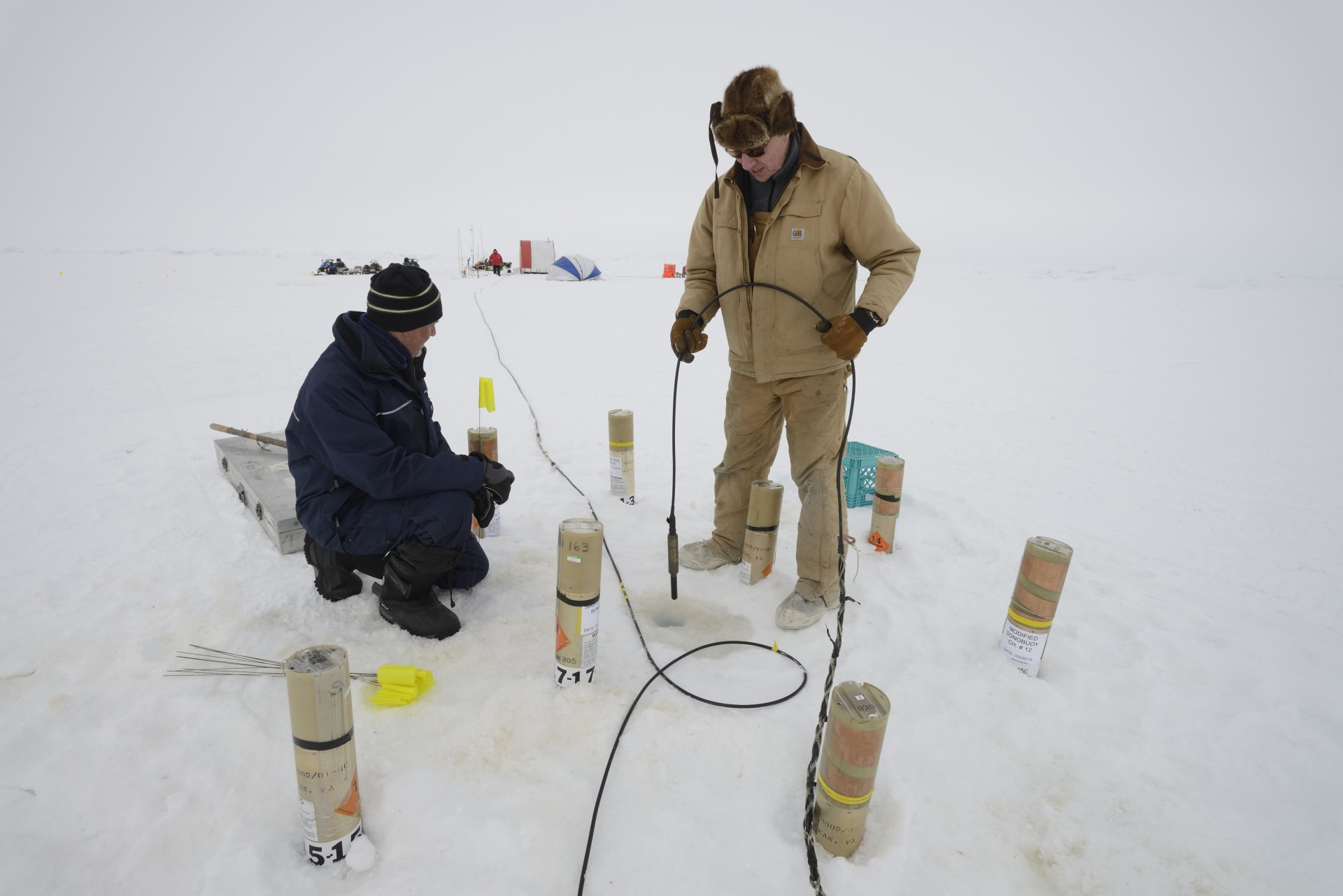 Hydrophones are put in the ice to monitor sound.