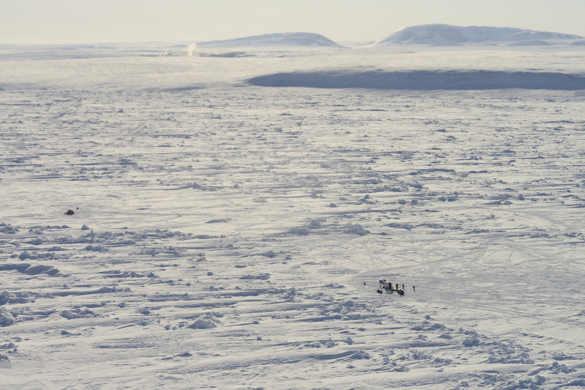 Aerial view: the geobuoy ice camp looks like two tiny dots in a sea of ice.