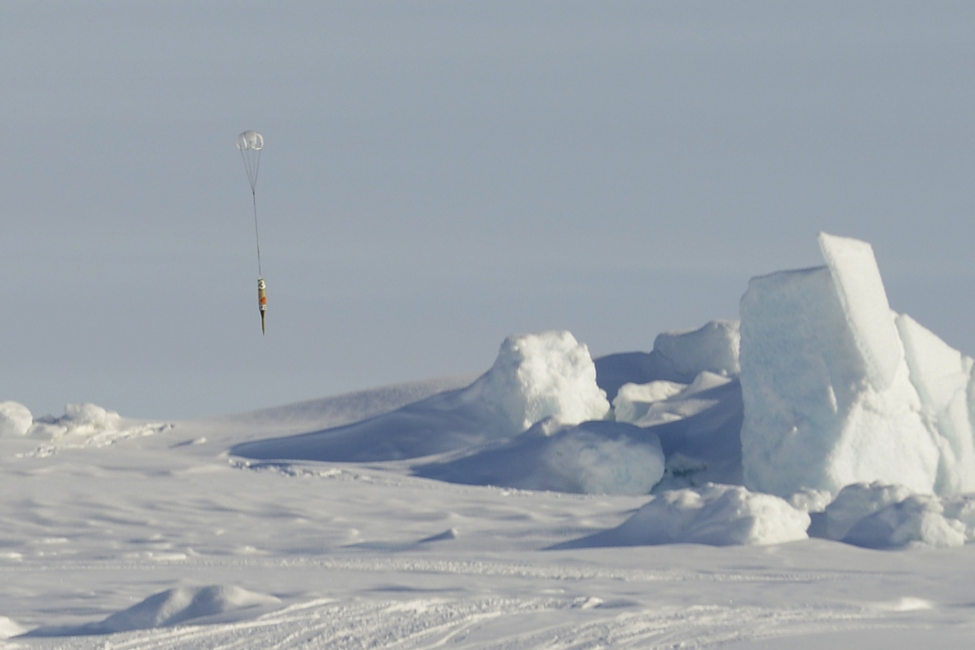An icepick geobuoy is released and opens its drag chute.