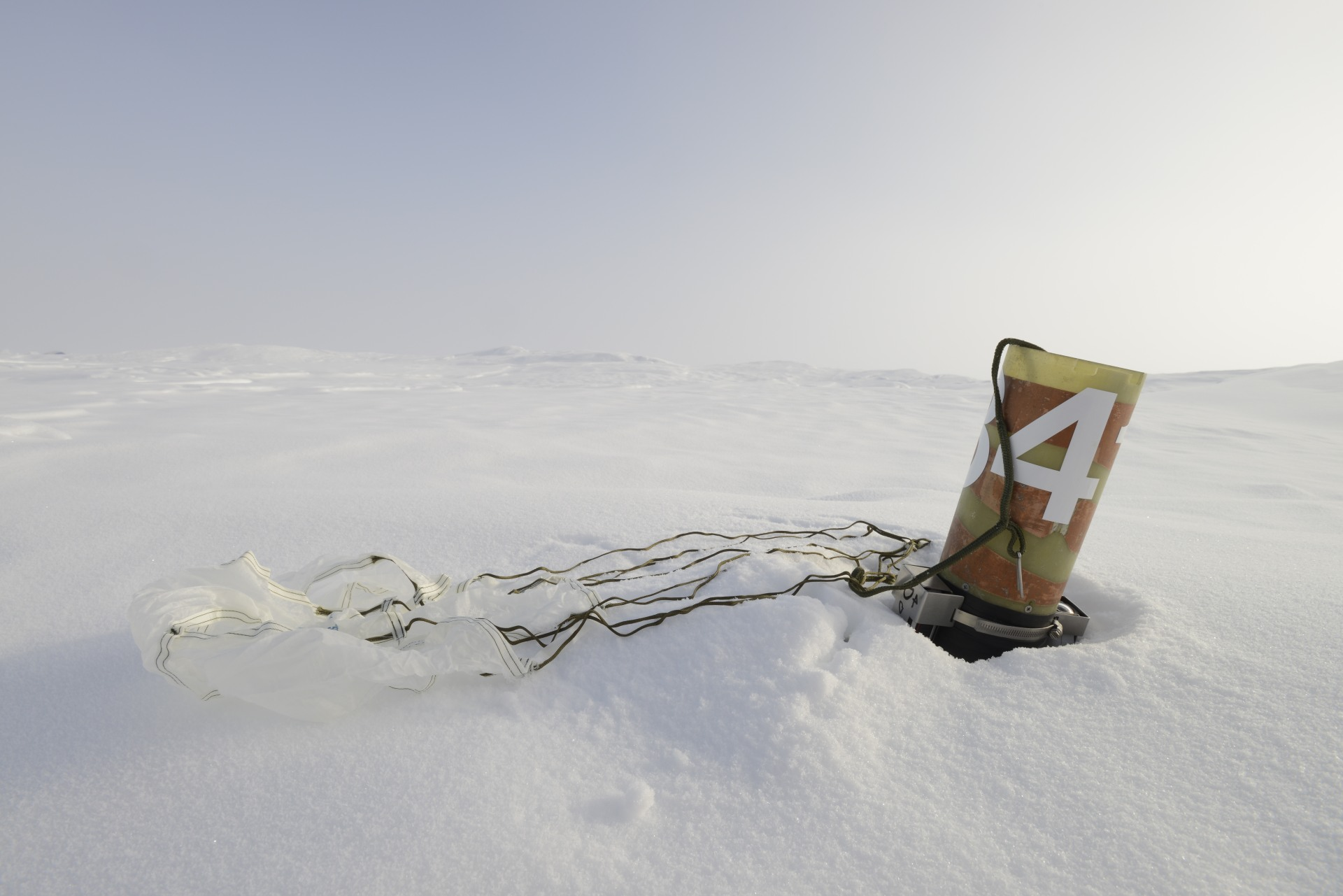 The icepick geobuoy hits the ice and detaches its drag chute.