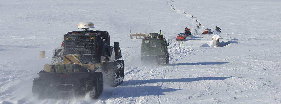 Convoy of snowmobiles, BV 206 and the Polaris Rampage tracked vehicles travel over land and sea ice to the austere camp on Little Cornwallis Island, from Resolute Bay, Nunavut, April 7, 2016.