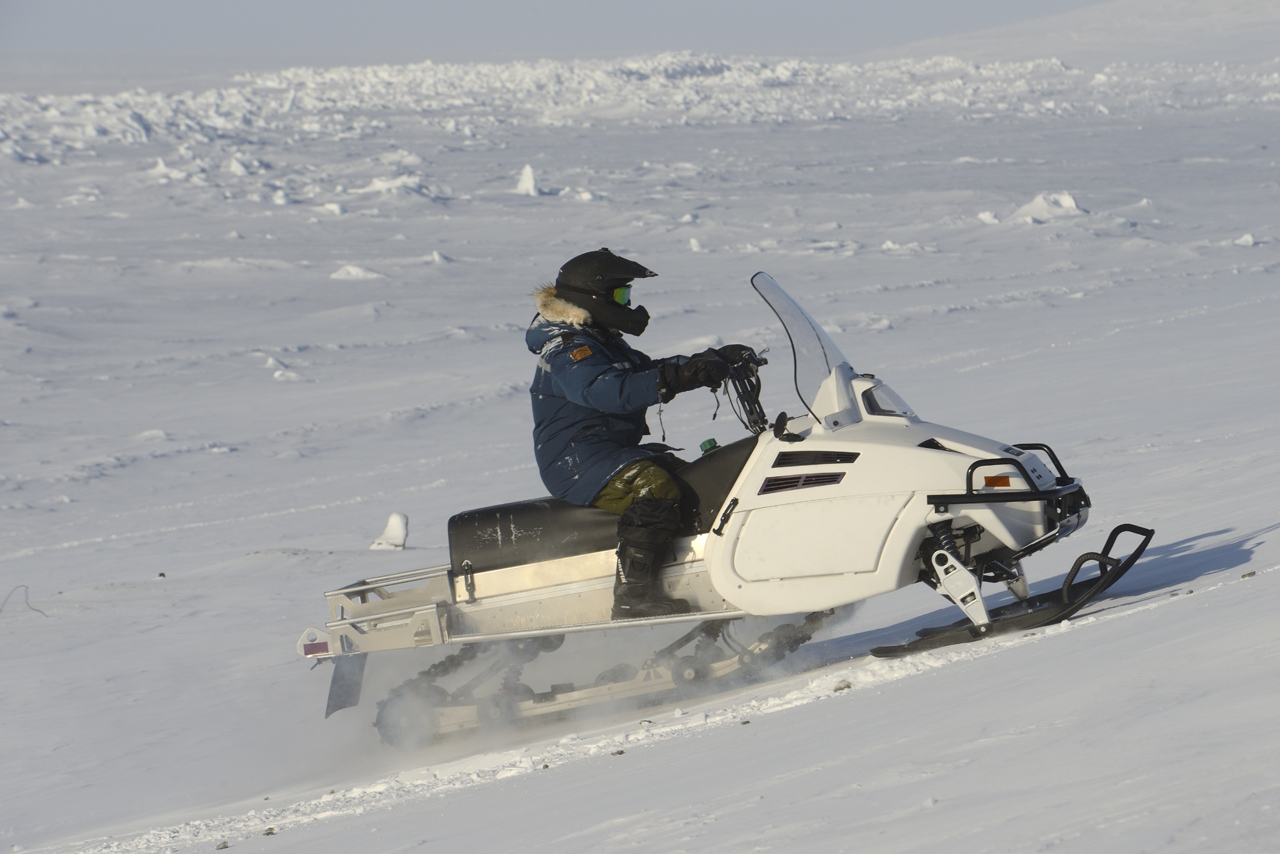 Defence Research and Development Canada and Canadian Armed Forces Joint Arctic Experiment (CAFJAE) 2016 team member Blaine Fairbrother test drives the DEW D900 snowmobile on Arctic terrain and ice during Operation NUNALIVUT at Resolute Bay, Nunavut, April 4, 2016. 