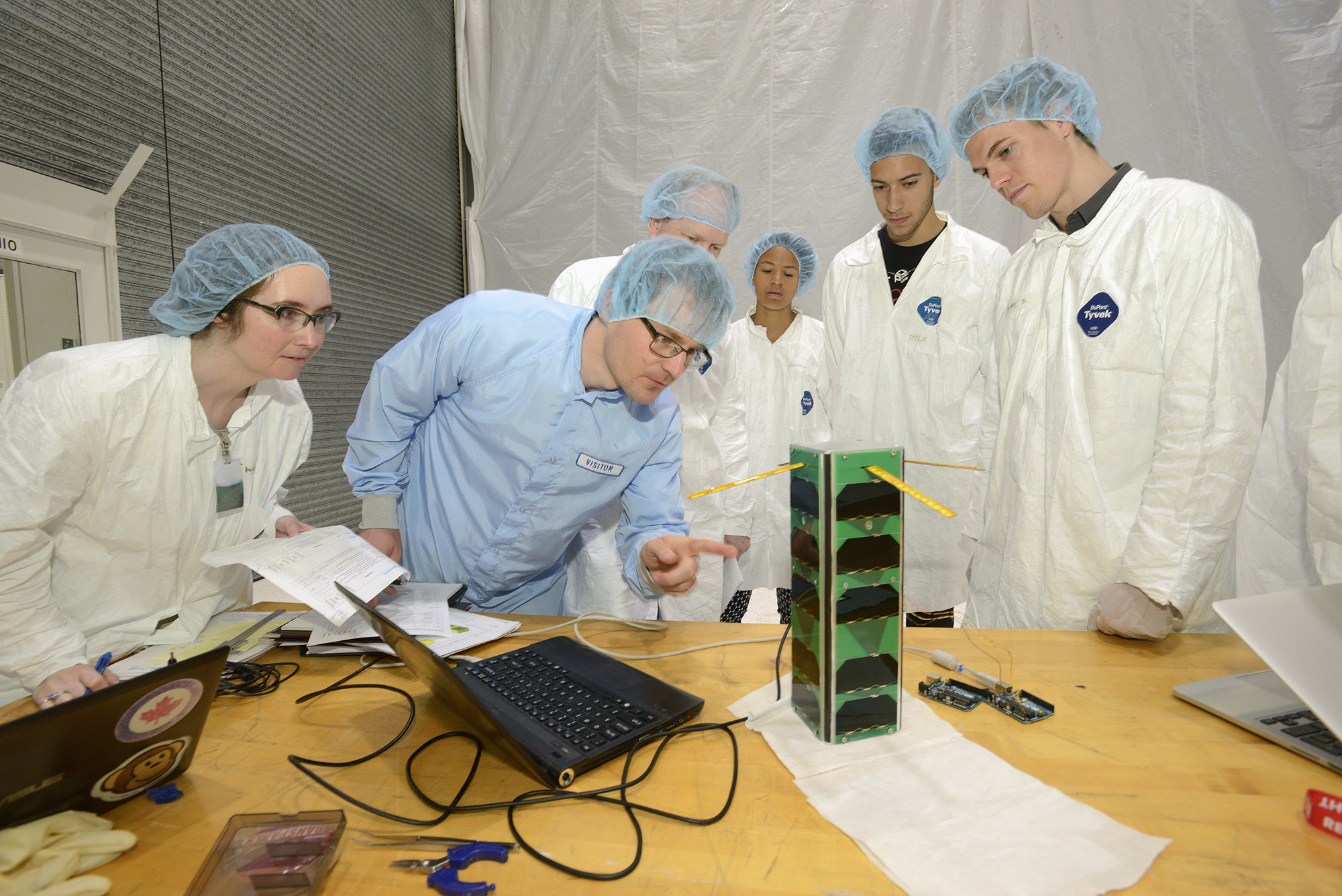 Judges evaluate the satellite designs in the Canadian Space Agency's David Florida Laboratory, Ottawa, Ontario.