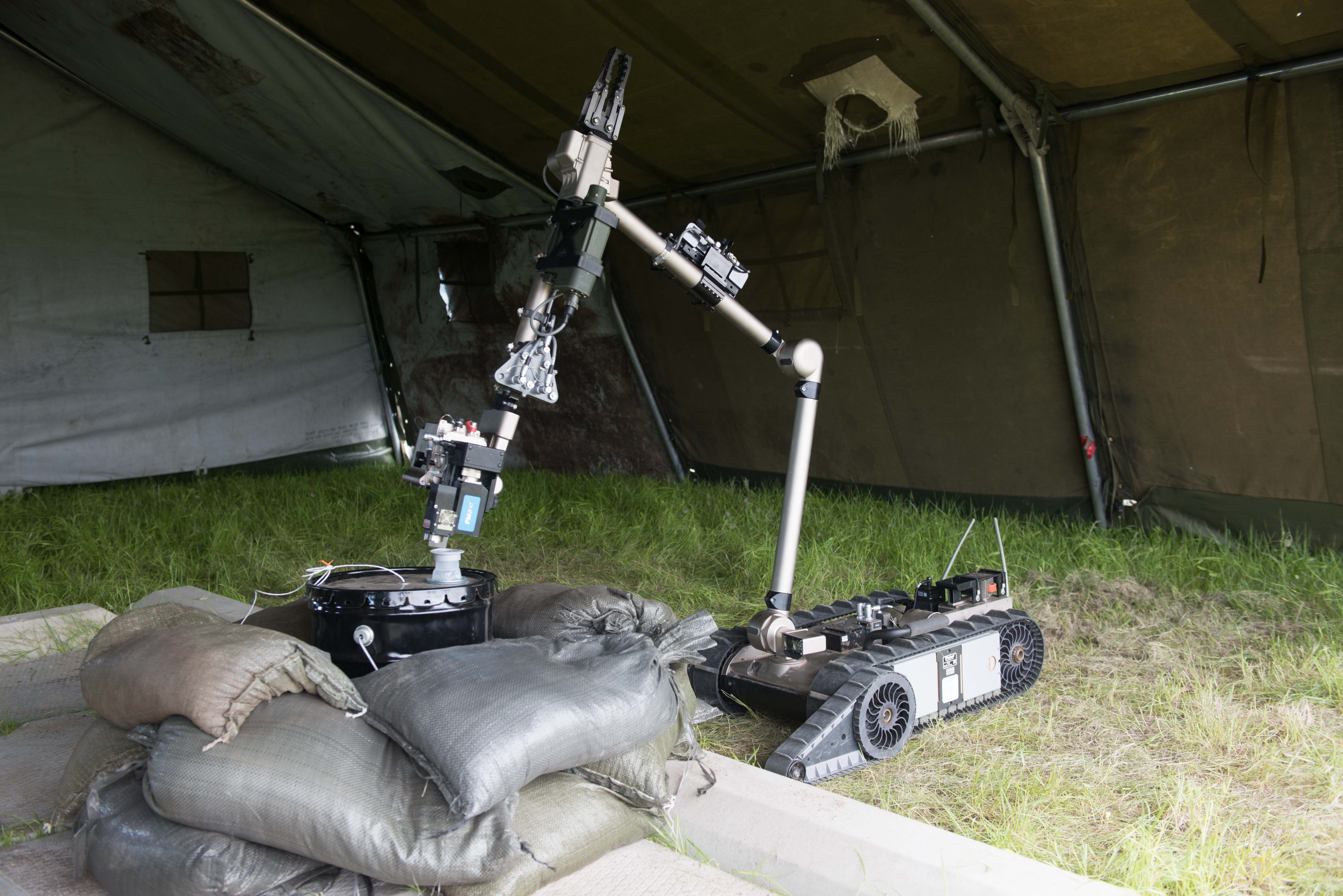 "The CBRN detector on the iRobot is used to ""sniff"" TNT in a bucket located onsite at DRDC – Suffield Research Centre on 3 June 2014."