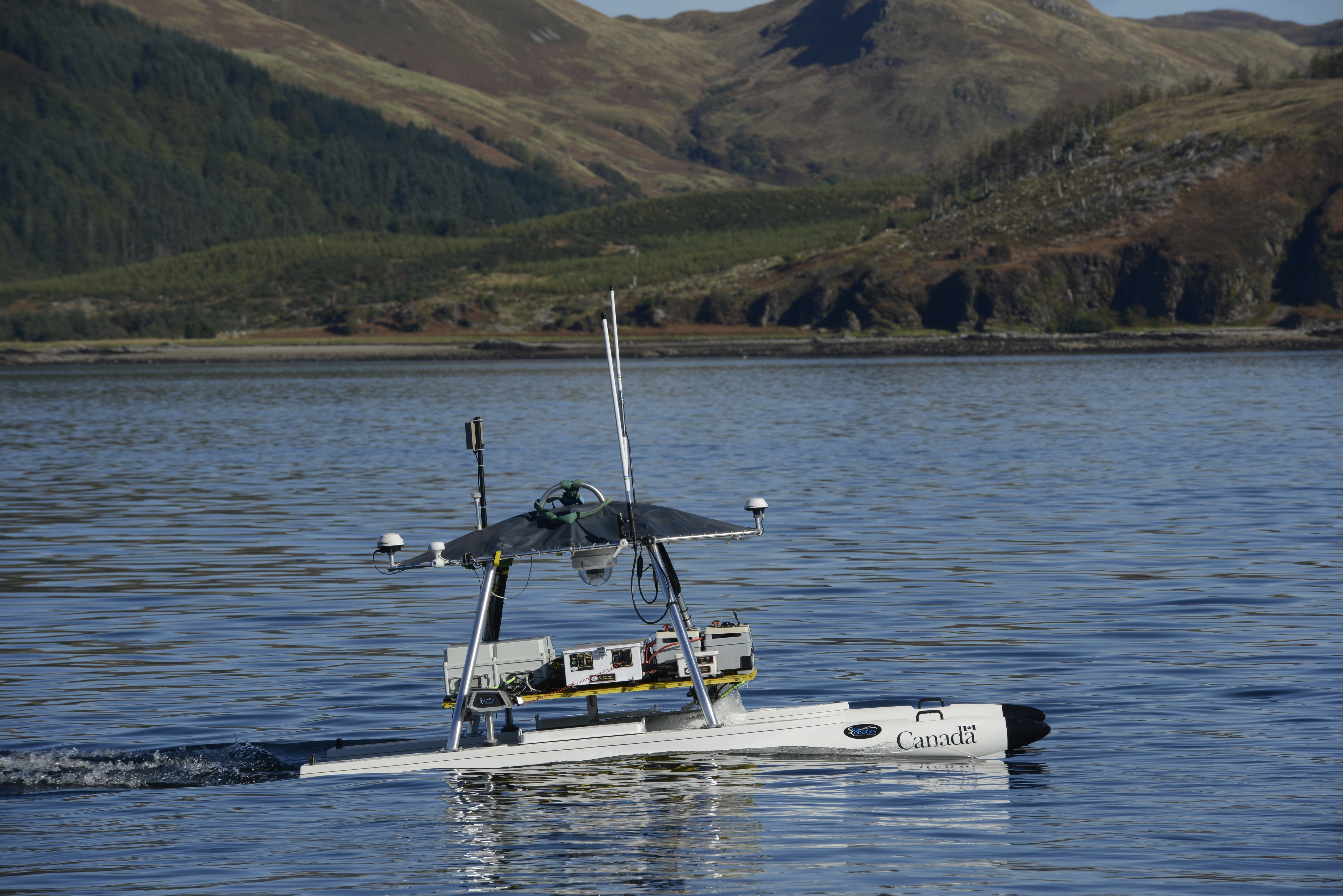 Defence Research and Development Canada's unmanned surface vehicle USV-2600 performs an autonomous mission in the water at Loch Alsh. Photo by Janice Lang, DRDC