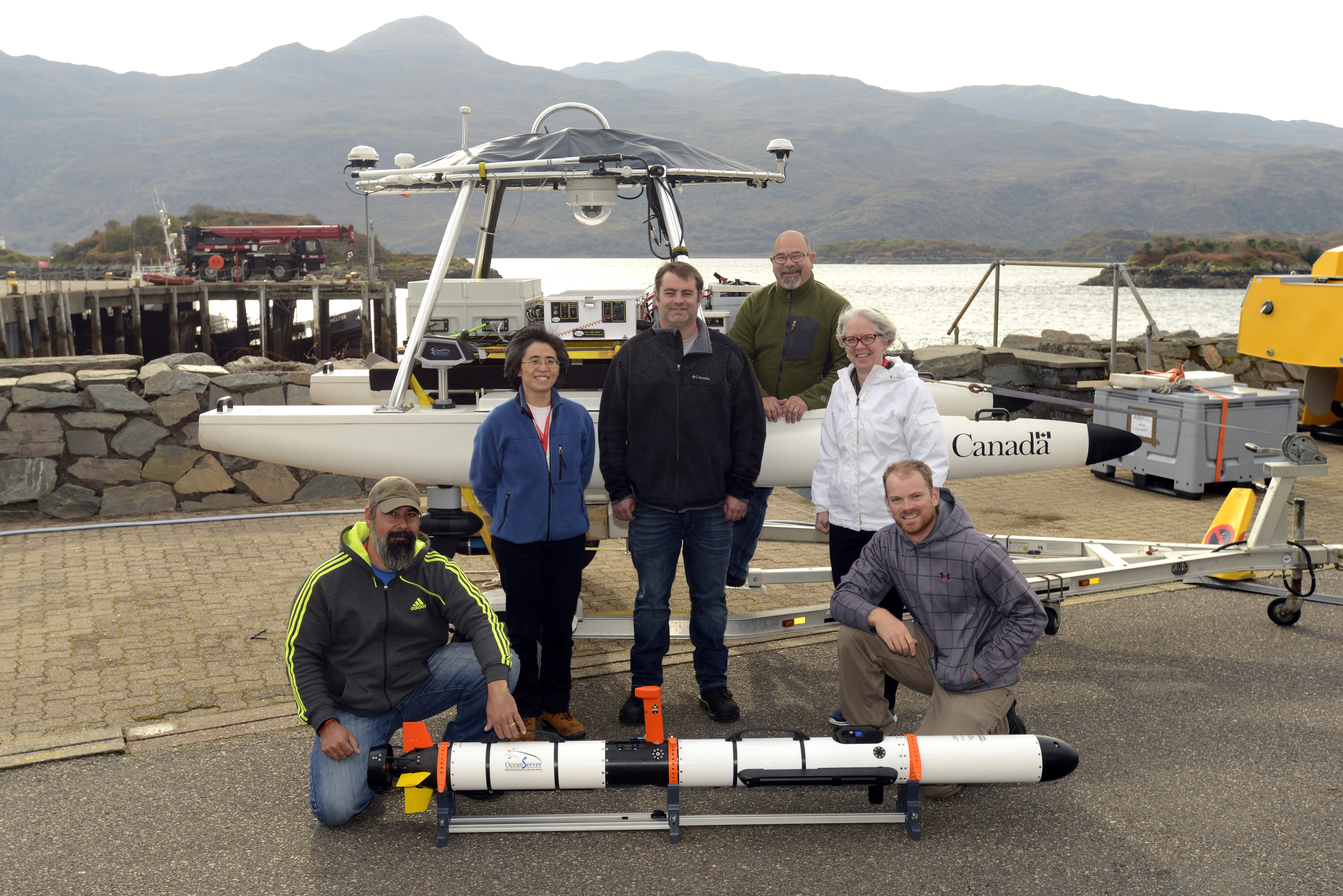 Defence Research and Development Canada's team for the Hell Bay portion of Ex UNMANNED WARRIOR 2016. Left to right: Tim Murphy, Dr. Mae Seto, Brett Pickrill, Al Tremblay, Elizabeth Blanchette, and Owen Shuttleworth.  John Fawcett and Anna Crawford also participated as members of the team, but are not pictured. Photo by Janice Lang, DRDC