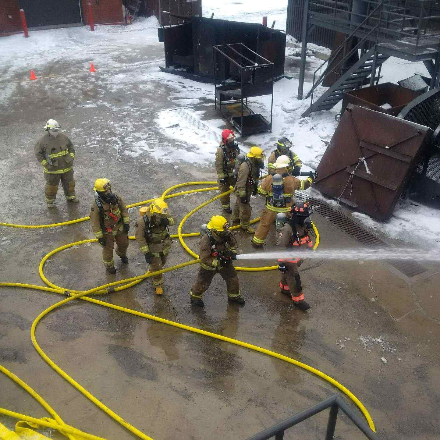 Firefighters practice defensive tactics.