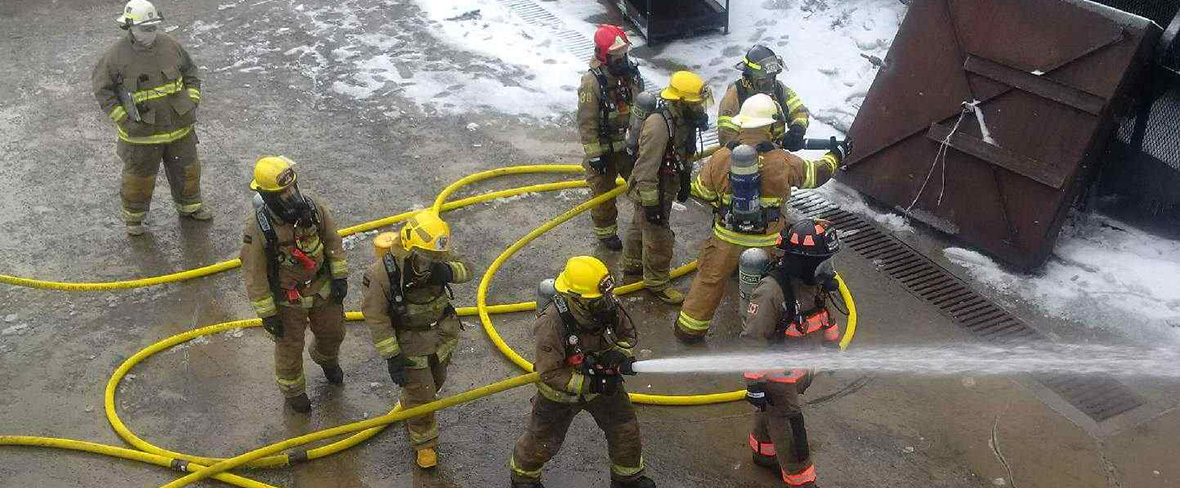 slide - Firefighters use foam to extinguish crude oil fire.