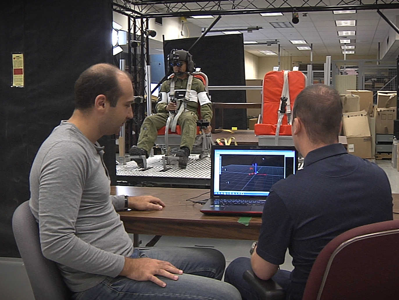 A still frame taken at video from a trial on neck strain, Karakolis is pictured on the left.