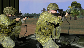 Two subjects train in a simulated mission in DRDC's Small Arms Trainer.
