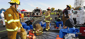 A full-scale live action event simulates an emergency response approach.