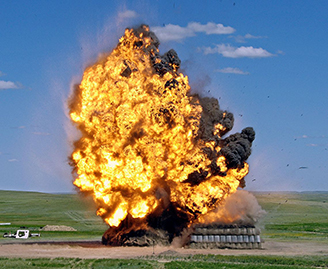 Numerous large scale explosive trials are conducted at DRDC's Experimental Proving Ground.