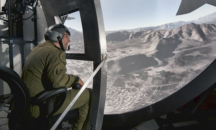 A Load Master trains in a virtual simulator to detect threats to aircraft.