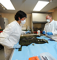 A post incident analysis of used personal protective equipment is conducted by Defence Scientists.